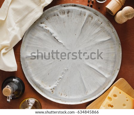 Food background, pizza backing sheet, cheese, olive oil, napkin, flat lay.