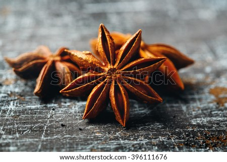 Food Background with Close-up of Star Anise on Vintage Black Table. Selective Focus.  - stock photo
