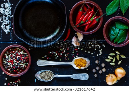 Food background with cuisine ingredients on dark vintage texture. Spices and herbs selection. Top view. Colorful natural additives. - stock photo