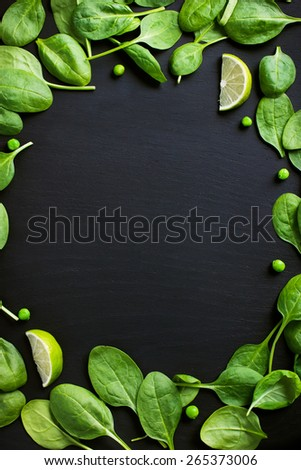 Food background with spinach, green peas and lime, top view - stock photo