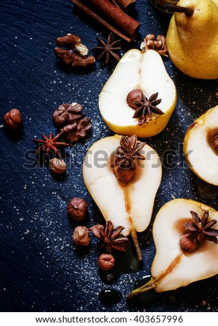 Food background: yellow pears with honey and spices, preparation for baking, dark background, top view - stock photo