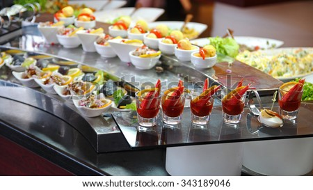 Food Buffet in Luxury Restaurant. Buffet Catering Food Arrangement on Table. - stock photo