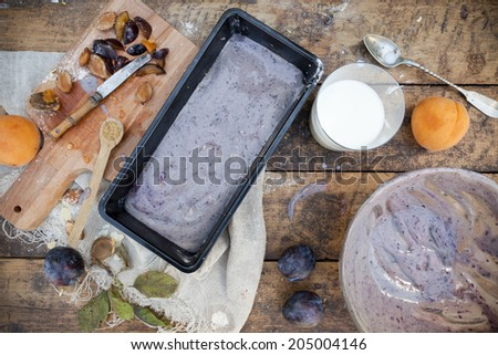 food composition with fruits plum cake making of in rustic background