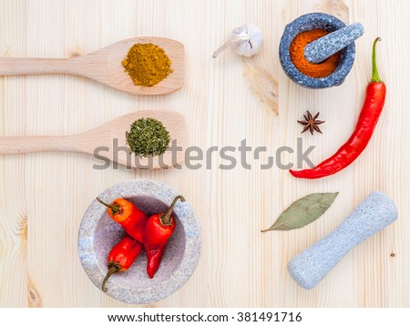 Food Cooking ingredients. Dried Spices herb bay leaves,turmeric,chili,star anise ,garlic and thyme  with the mortar on rustic wooden background. - stock photo