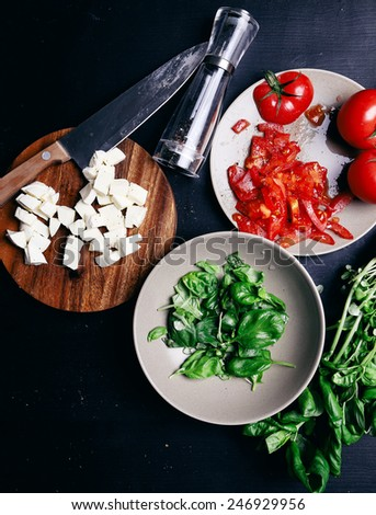 Food, cooking. Salad with mozzarella on the table - stock photo