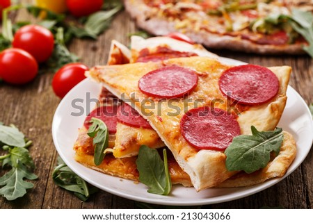 Food. Delicious pizza on the wooden table - stock photo