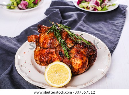 Food. Delicious roasted chicken on the table - stock photo