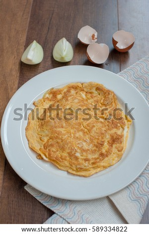 Food Delicious Thai Style Omelet with onion on white plate