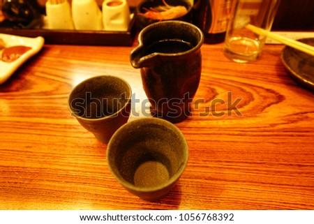 https://thumb9.shutterstock.com/display_pic_with_logo/167494286/1056768392/stock-photo-food-drink-in-izakaya-in-tokyo-1056768392.jpg