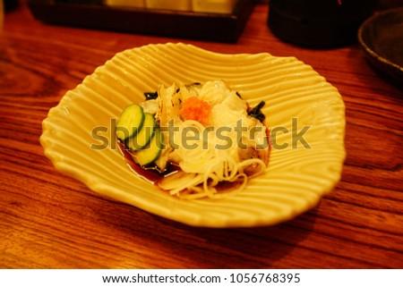 https://thumb9.shutterstock.com/display_pic_with_logo/167494286/1056768395/stock-photo-food-drink-in-izakaya-in-tokyo-1056768395.jpg