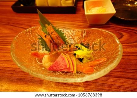 https://thumb9.shutterstock.com/display_pic_with_logo/167494286/1056768398/stock-photo-food-drink-in-izakaya-in-tokyo-1056768398.jpg