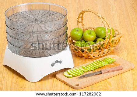 Food dryer and a green apples - stock photo