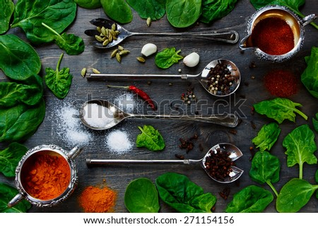 Food Elements - Herbs and spices selection, vintage metal spoons and old dark wood - cooking, healthy eating. Top view. - stock photo