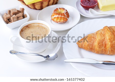 food for breakfast.coffee, croissant, butter and jam