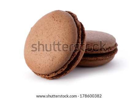 Food: group of fresh chocolate macarons, isolated on white background - stock photo