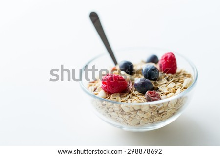 food, healthy eating and diet concept - close up of bowl with granola or muesli on table - stock photo