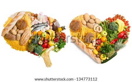 Food in a shape of a brain and heart on white background - stock photo