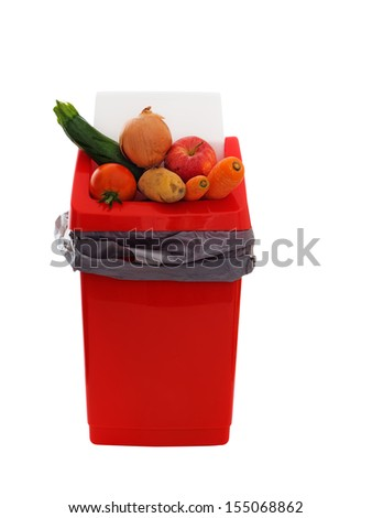 Food in garbage - perfectly usable food thrown away. - stock photo
