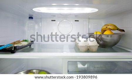 Food in refrigerator - stock photo