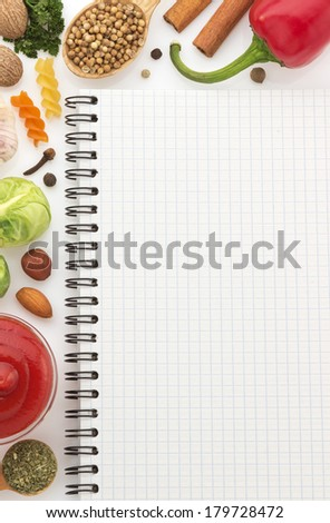 food ingredients and recipe book on white background - stock photo
