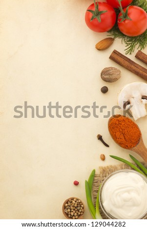 food ingredients and spices on aged background - stock photo