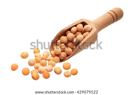 Food ingredients: heap of whole dried yellow peas in a wooden scoop, on white background - stock photo