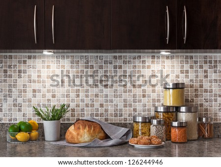 Food ingredients in a contemporary kitchen with cozy lighting. - stock photo