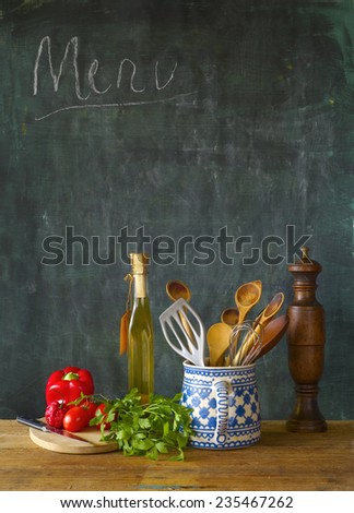 Food ingredients,kitchen utensils, black board, free copy space - stock photo