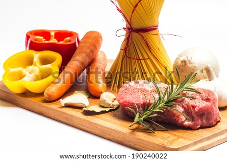 Food ingredients on the cutting board. Isolated with light shadow. - stock photo