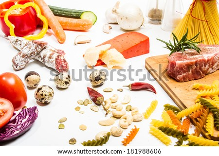 Food ingredients scattered around the white background. Isolated with light shadow.