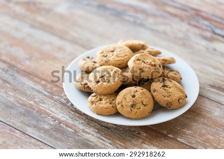 food, junk-food, culinary, baking and eating concept - close up of chocolate oatmeal cookies on plate - stock photo