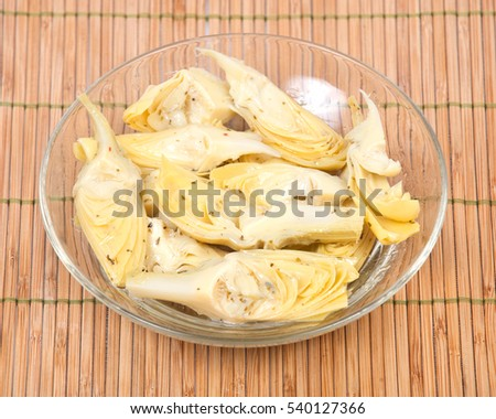 Food of love, marinated artichokes in bowl on bamboo placemat