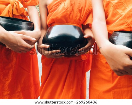 food offering to a monk - stock photo
