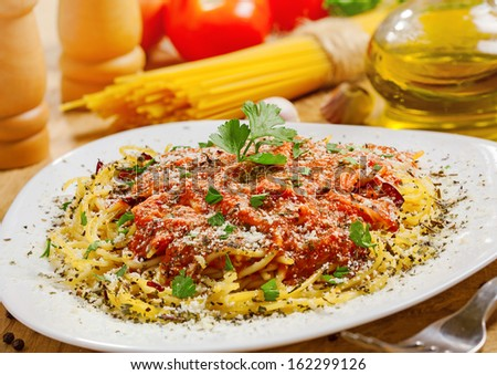 Food, Pasta with sauce and parmesan cheese, ingredients on background - stock photo