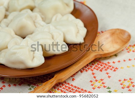 Food - plate with russian ravioli with meat on a table