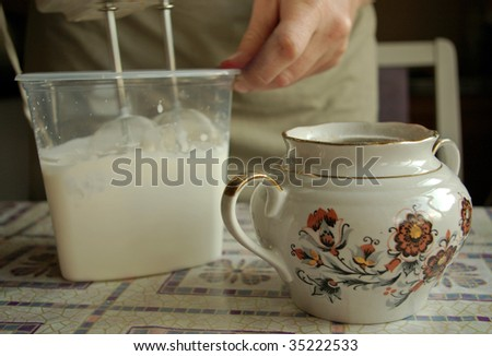 food preparation with mixer and sugar bowl - stock photo