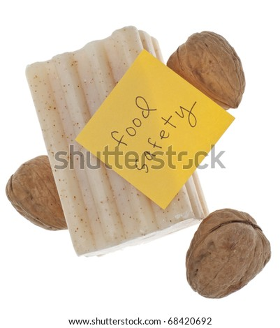 Food Safety Concept with Walnuts, Soap and Note About Food Safety.  Isolated on White with a Clipping Path.