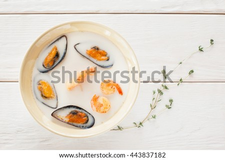 Food Seafood Cream Soup White Bowl Shrimp Mussel Creative Chinese Japanese Cuisine Restaurant Concept - stock photo