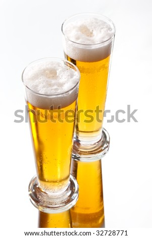 food series: two glasses of light beer - stock photo