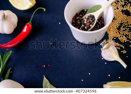 Food spice seasoning ingredients for cooking in cuisine on white background. Dry powder curry, ginger, chili, rosemary, onion, paprika, garlic. Asian  yellow, green colorful aroma condiment.   - stock photo