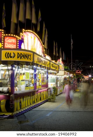 Food stands at a state fair. - stock photo