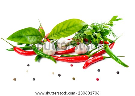 food still life with fresh ripe red, green pepper, garlic and greens is isolated on the white background - stock photo