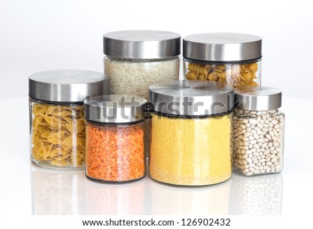 Food storage. Food ingredients in glass jars, on white background.