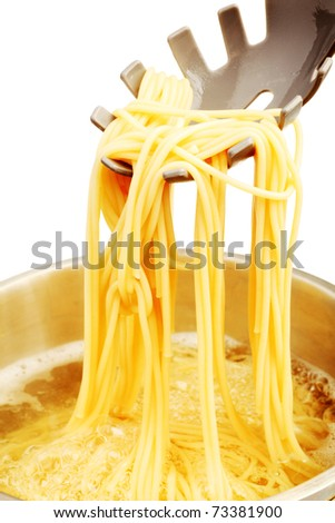 Food theme: spaghetti in a boiling water. Isolated over white background. - stock photo