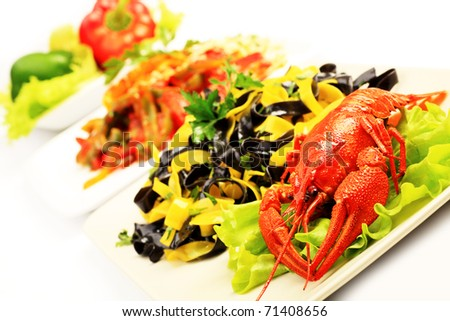 Food theme: tasty colorful pasta dish with boiled lobsters. - stock photo
