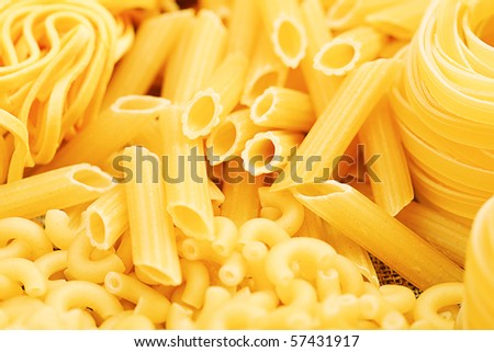 Food theme: uncooked pasta background. - stock photo