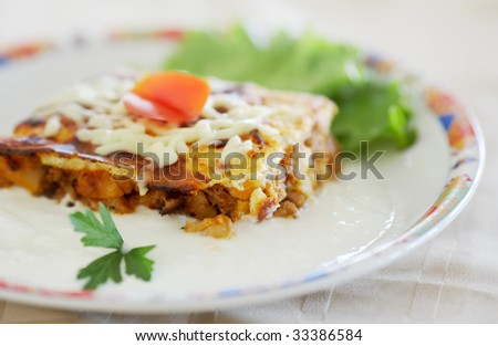 Food, traditional Bulgarian moussaka food in a dish with Bulgarian yogurt