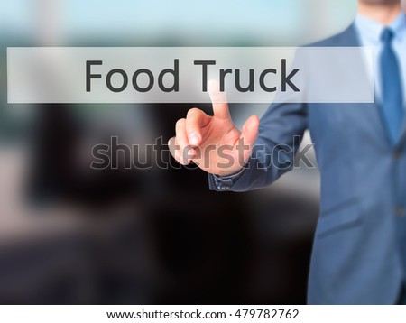 Food Truck - Businessman hand pressing button on touch screen interface. Business, technology, internet concept. Stock Photo