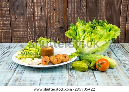 Food Vietnam With fresh vegetables Grilled Pork Ball Served with Deipping Suace and Paper Rice Nem Nuong Plate - stock photo
