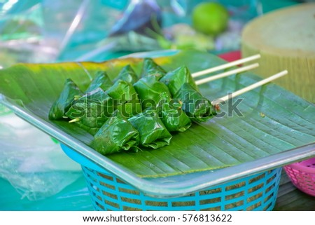 Food wrapped in  Chaplo  leaves on bananaleaf, Thai snack, Thailand